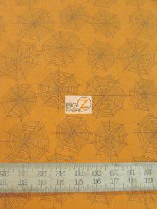 Orange Spider Webs Cotton Fabric